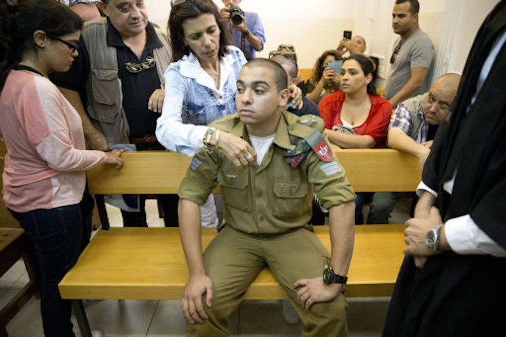 Israeli soldier sentenced to prison for killing wounded Palestinian attacker