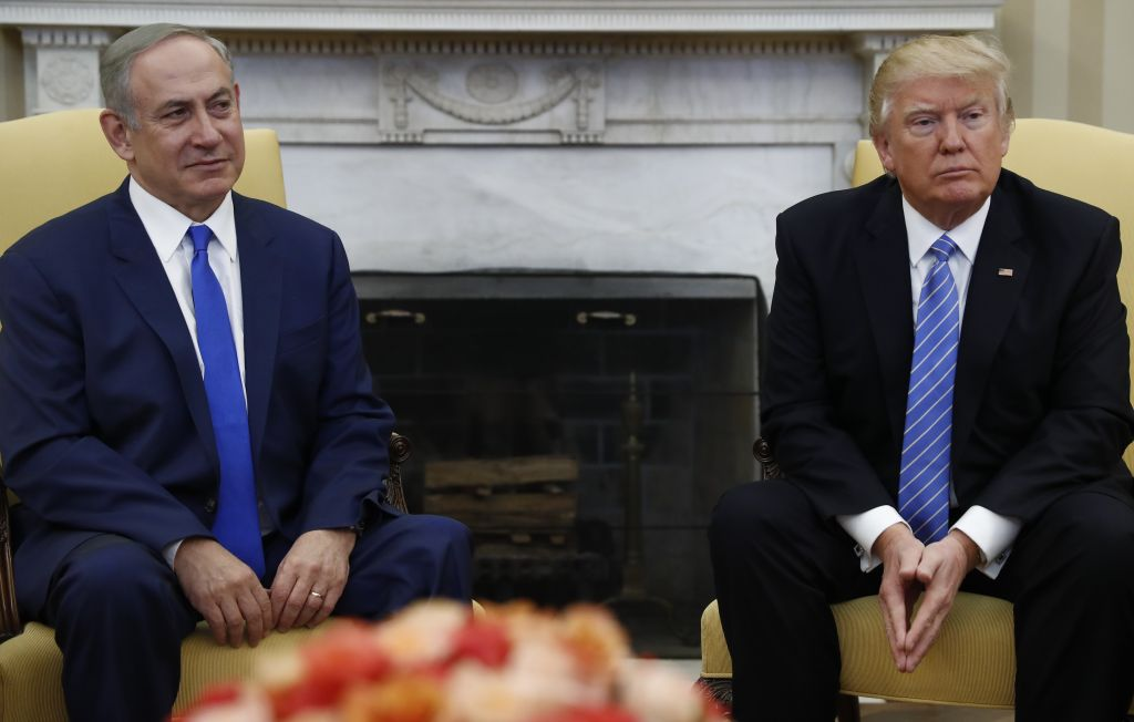President Donald Trump and Israeli Prime Minister Benjamin Netanyahu meet in the Oval Office of the White House in Washington, February 15, 2017. (AP/Carolyn Kaster)
