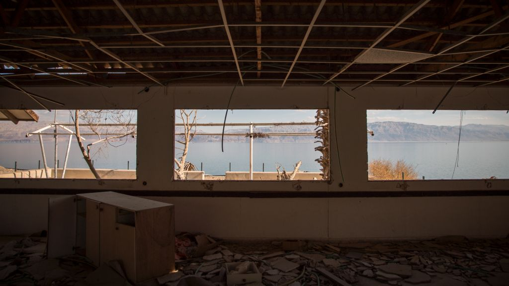 A view of the Dead Sea from an abandoned restaurant at the Kibbutz Ein Gedi public beach on January 3, 2017. (Luke Tress/Times of Israel)