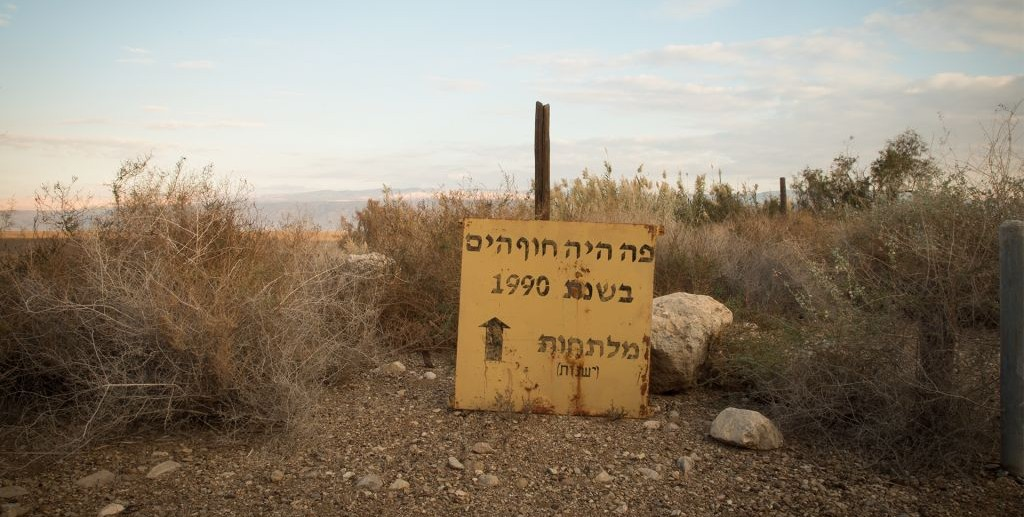 A sign at Einot Tzukim, on the shores of the northern Dead Sea, marks the water level in 1990. On January 6, 2016, the water's edge was more than a kilometer away. (Melanie Lidman/Times of Israel)