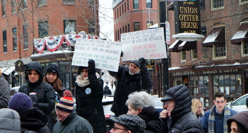 At the New England Holocaust Memorial in Boston, Massachusetts, activists gather in support of refugees on February 12, 2017 (Kaila Fleisig)