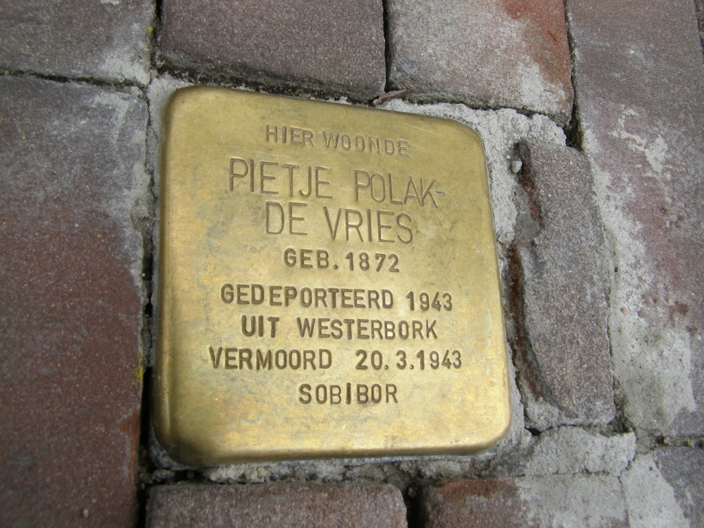 A memorial cobblestone in Harlingen reads: 'Here lived Pitje Polak-de Vries, born 1872, deported 1943 to Westerbork, murdered 3/20/1943.' (Cnaan Liphshiz/JTA)