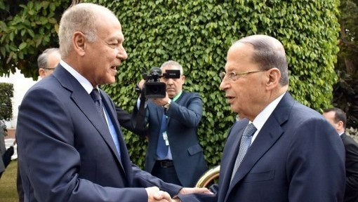 Arab League Secretary General Ahmed Abul-Gheit (L) welcomes Lebanese President Michel Aoun at an Arab League meeting in Cairo on February 14, 2017. / AFP PHOTO / STRINGER