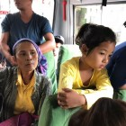 girl in yellow shirt on bus