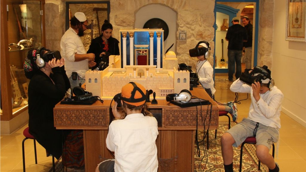 Visitors participate in an exhibit in the Hebrew Room of the Hebrew Music Museum in Jerusalem. (Shmuel Bar-Am)