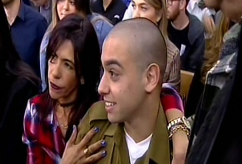 Elor Azaria being hugged by his mother in a Tel Aviv military court on February 21, 2017. (screen capture: Channel 2)