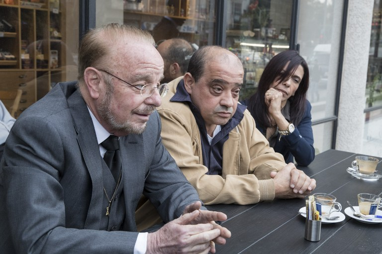 Elor Azaria's father Charlie, center, mother Oshrat and defense attorney Yoram Sheftel, hold a press conference on March 1, 2017, in Tel Aviv, to announce an appeal against Azaria's 18-month jail term for manslaughter. (AFP Photo/Jack Guez)