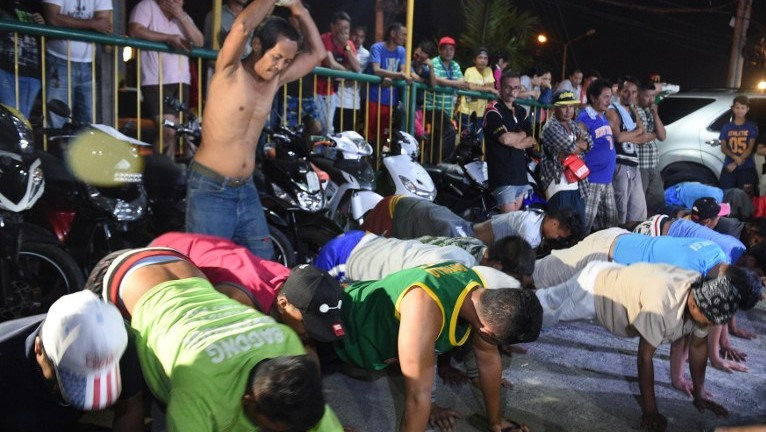2017 shows detained drunks and shirtless men doing 60 push-ups as punishment during the police's operation called