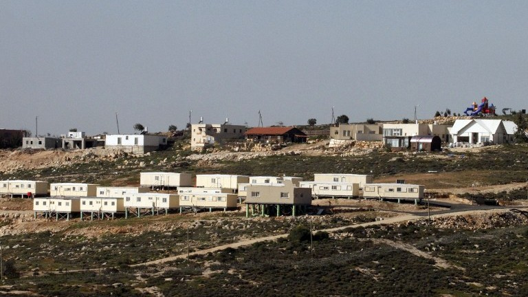A picture taken from the Palestinian village of Sa'ir shows the Israeli settlement of Metzad on March 15, 2017. (AFP Photo/Hazem Bader)