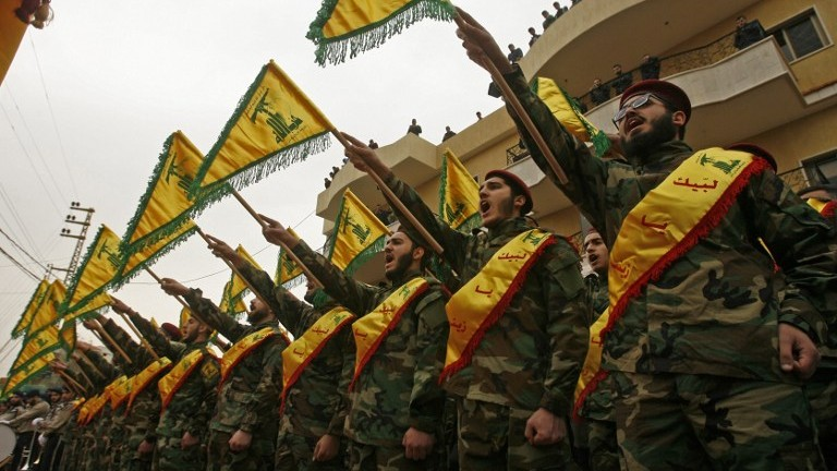Fighters of the Shiite Hezbollah terror group attend the funeral of a comrade who died in combat in Syria in the southern Lebanese town of Kfar Hatta