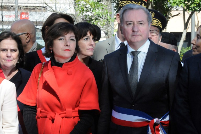 Toulouse's mayor Jean-Luc Moudenc (R) and head of the Occitanie regional council Carole Delga (C) take part in a cermony in tribute of the victims of jihadist Mohammed Merah in 2012, on March 19, 2017 in Toulouse, on the fifth anniversary of Merah's shooting at a jewish school in Toulouse. (AFP PHOTO / PASCAL PAVANI)