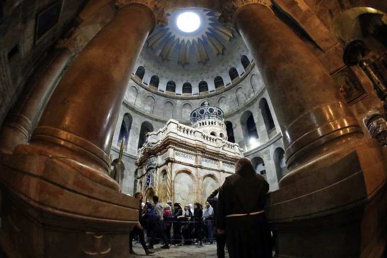 A picture taken on March 21, 2017 at the Church of the Holy Sepulchre in the Old City of Jerusalem shows the renovated Edicule of the Tomb of Jesus (Thomas Coex/AFP)
