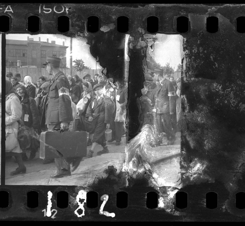 A damaged negative of ghetto police escorting residents for deportation. (Henryk Ross/Art Gallery of Ontario, gift from the Archive of Modern Conflict/Courtesy Museum of Fine Arts)