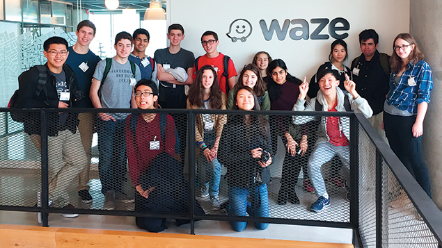The students mug for the camera at the Tel Aviv headquarters of Waze, the GPS giant.