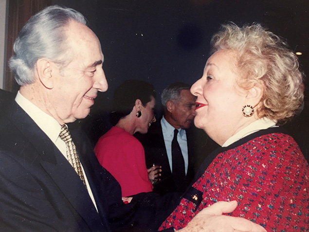 Former Hadassah president Deborah Kaplan is embraced by Shimon Peres.