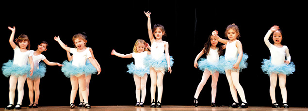 Children at the JCC's nursery school meet weekly with JCC seniors to celebrate Shabbat or holidays, or for the seniors to read to the children. Here, young dancers perform at a Lavish Lunch.