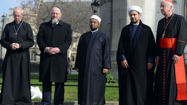 (From the left) Archbishop of Canterbury, the Most Rev Justin Welby, Chief Rabbi Ephriam Mirvis, Sheikh Ezzat Khalifa, Sheikh Mohammad al Hilli and Cardinal Vincent Nichols, Archbishop of Westminster, take part in a vigil outside Westminster Abbey.