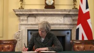 Prime Minister Theresa May in the cabinet signing the Article 50 letter, as she prepares to trigger the start of the UK's formal withdrawal from the EU   (Photo credit: Christopher Furlong/PA Wire)
