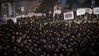 Thousands of ultra orthodox Jews protest the arrest of ultra-Orthodox draft dodgers, at a rally against army recruitment in Jerusalem. (Photo by: JINIPIX)