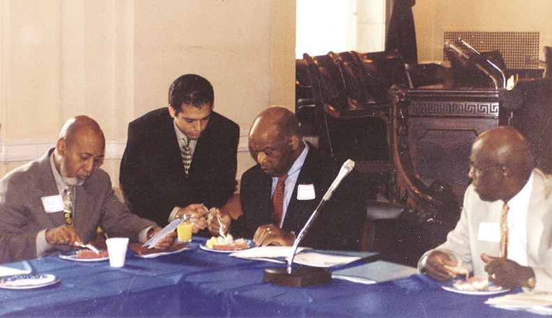 At the congressional conference on black-Jewish relations that was his brainchild, Mr. Cohen talks with congressmen, from left, Alcee Hastings, John Lewis, and Ed Towns.