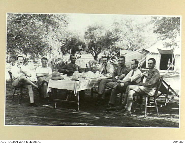 Officers sitting around a table in an olive grove in Ramleh, Palestine, 1918. Headquarters 40TH (Army) Wing RAF. (Australian War Memorial, public domain)