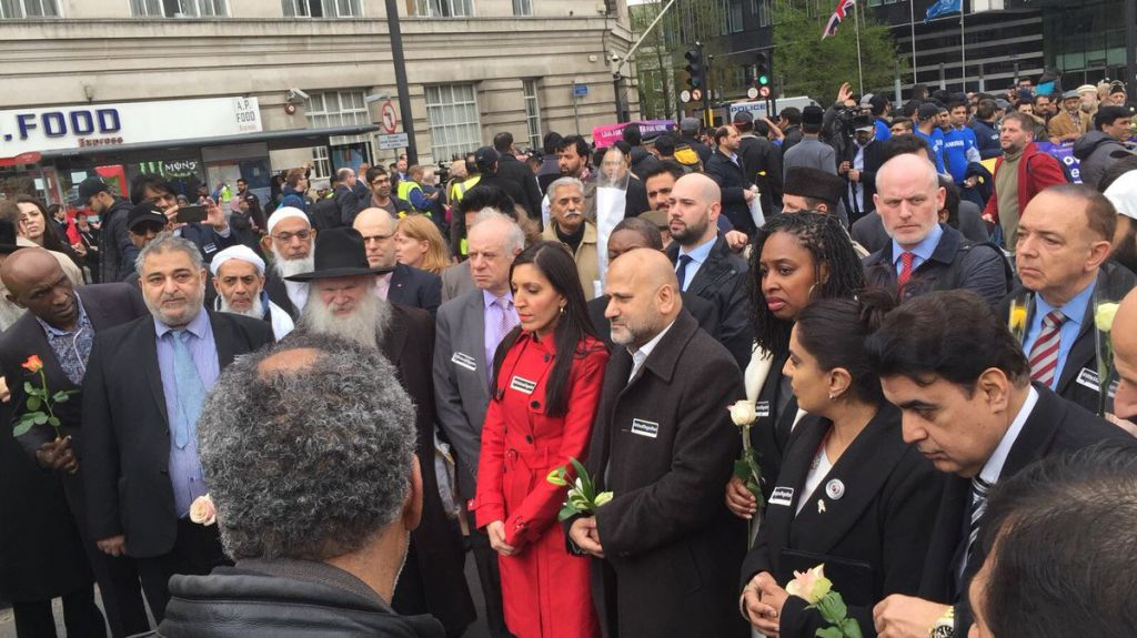 Rabbi Hershel Gluck and Board of Deputies president Jonathan Arkush (second and third from left) at a vigil in Westminster to mark a week since terror. (Photo credit: Shomrim on Twitter)