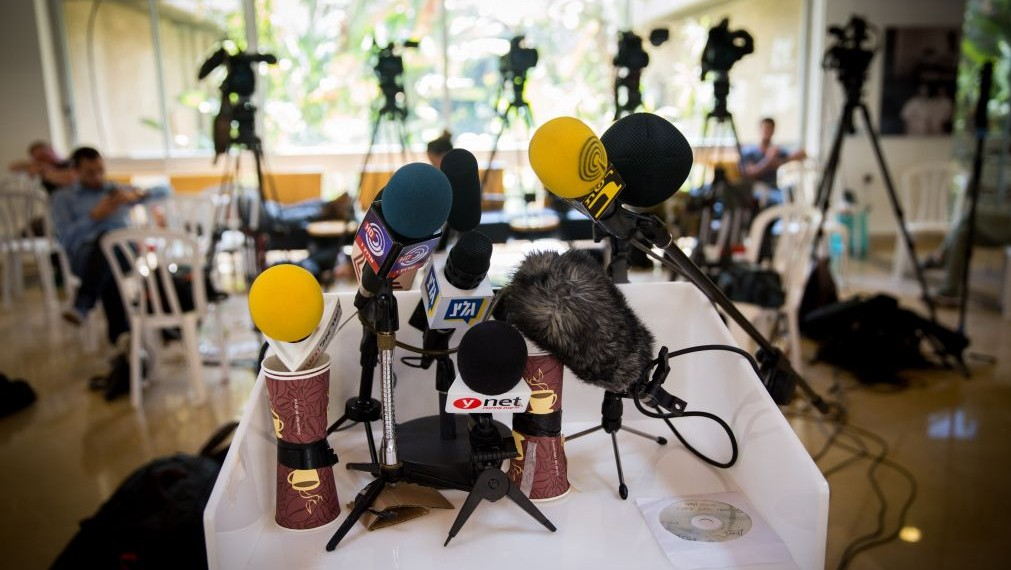 Microphones and video cameras of Israeli media outlets set up for press conference. (Miriam Alster/Flash90)