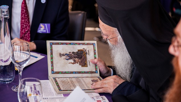 Archbishop Gregorios of the Greek Orthodox Church, Great Britain and Thyateira, reading a Hagaddah