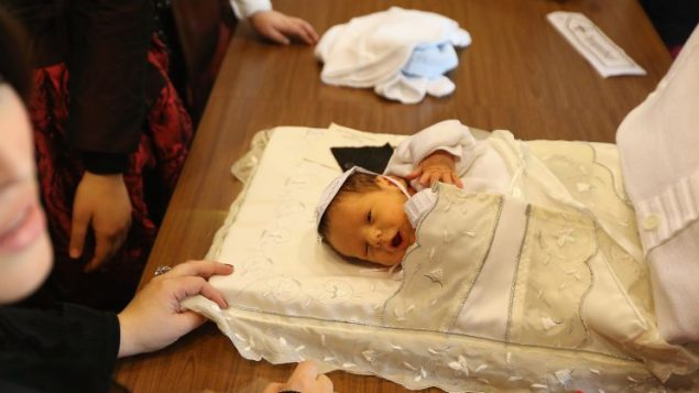 An 8-day-old baby at his bris ceremony. Getty Images