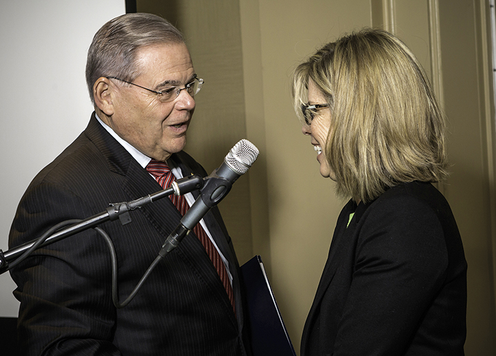 Senator Robert Menendez talks to Donna Weintraub, a federation board member who was instrumental in creating iCan.