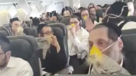 Screenshot from a video showing ultra-Orthodox Jewish passengers on board a flight from London Stansted to Rzeszow in Poland, March 19, 2017. The plane made an emergency landing in Amsterdam. (Hiemishe LIVE NEWS/Twitter)