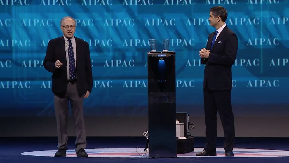 Alan Dershowitz and AIPAC's national managing director Elliot Brandt showcase Israeli company Water Gen's water-making technology, March 26, 2017 (Screen capture)