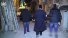 A Charedi man, handcuffed, being taken away by Israeli police