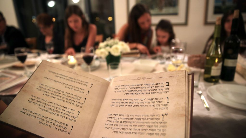 Illustrative photo of an Israeli family seen during the Passover seder meal on the first night of the eight-day long Jewish holiday, in Tzur Hadassah on April 22, 2016. (Nati Shohat/Flash 90)