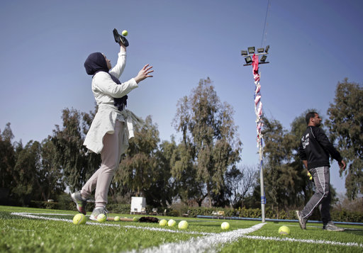 In this Sunday, March 19, 2017 photo, Palestinian women train for an all women's baseball game, on a soccer field in Khan Younis, southern Gaza Strip. (AP Photo/Khalil Hamra)