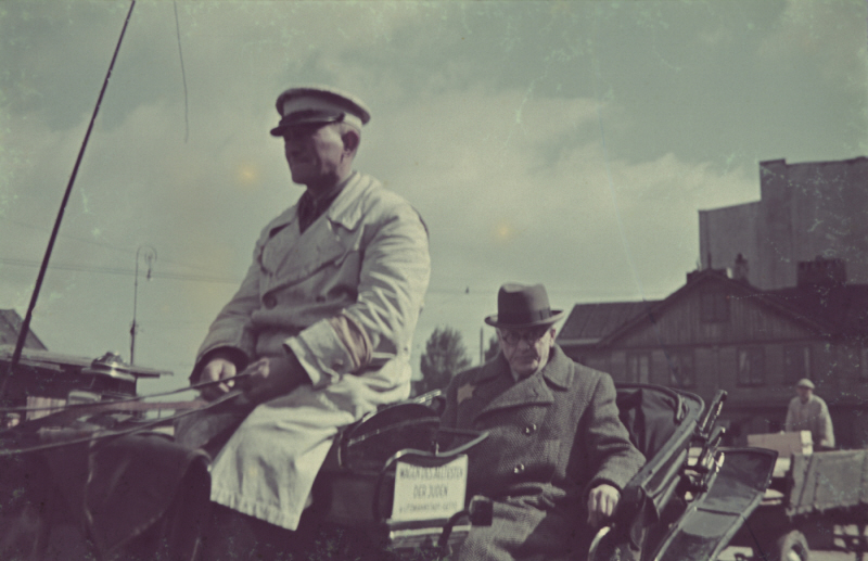 During his tenure as chairman of the Lodz Ghetto's Nazi-installed Jewish Council, Chaim Rumkowski is driven by a horse-drawn carriage through the ghetto (United States Holocaust Memorial Museum)