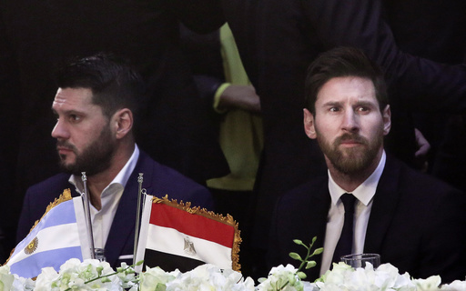 In this Tuesday, Feb. 21, 2017, file photo, FC Barcelona's Lionel Messi, (R), attends a gala dinner held at the Mena House in Giza, Egypt. (AP Photo/Nariman El-Mofty, File)
