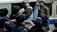 Police officers detain an opposition supporter during a rally in Vladivostok, Russia