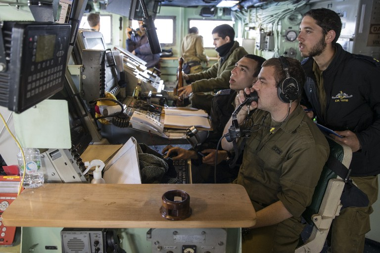 "Israeli soldiers onboard the Israeli vessel Saar 5 Class Corvette ""INS Hanit"" take part in the ""Novel Dina 17"" training session in the Mediterranean Sea on April 4, 2017. ( AFP PHOTO / JACK GUEZ)"