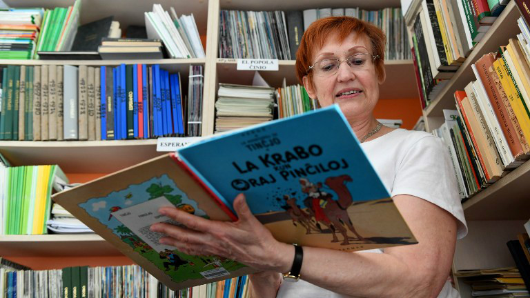 Elzbieta Karczewska, a volunteer at the Esperanto library, reads a book inside the Ludwik Zamenhof center in Bialystok, eastern Poland, on April 5, 2017.(Janek SKARZYNSKI / AFP)