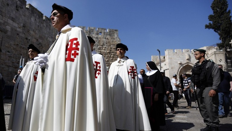 Knights of the Holy Sepulchre attend the Easter Sunday procession in Jerusalem's Old City on April 16, 2017. (AFP Photo/Gali Tibbon)