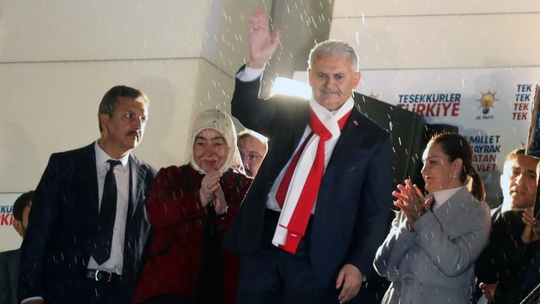 Turkish Prime Minister Binali Yildirim (3rd-R) waves at his supporters at the AKP headquarters in Ankara, on April 16, 2017. (AFP Photo/Adem Altan)