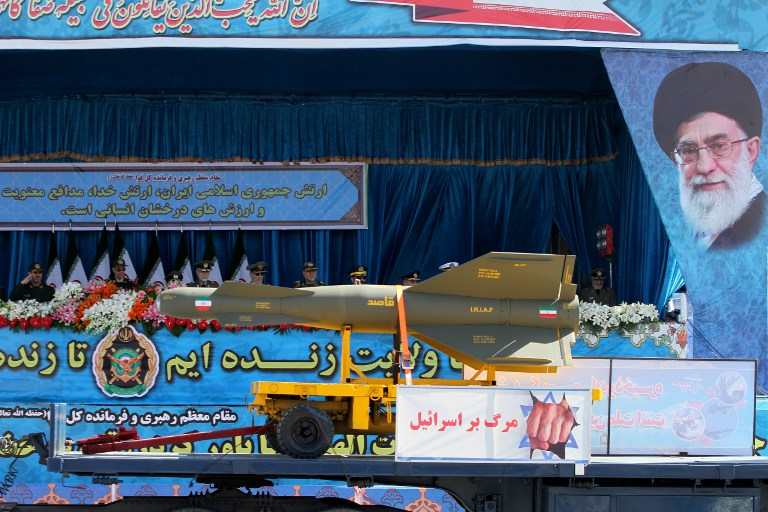 """An Iranian military truck displays a banner reading """"Death to Israel"""" as it carries munitions during a parade marking the country's National Army Day, in Tehran, April 18, 2017. (AFP/Atta Kenare)"""