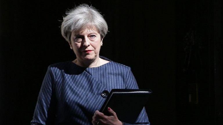 British Prime Minister Theresa May walks out of 10 Downing Street to make a statement to the media in central London on April 18, 2017. (AFP PHOTO / Daniel LEAL-OLIVAS)