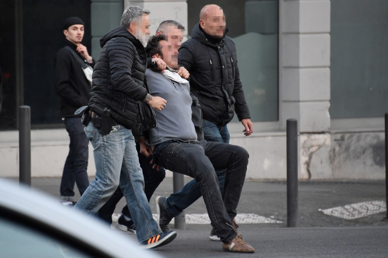 Police detain a man during a protest against the far-right Front National (FN) in Marseille on April 19, 2017 ( AFP PHOTO / SYLVAIN THOMAS)
