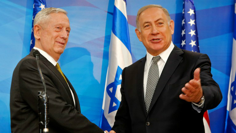 Prime Minister Benjamin Netanyahu (R) shakes hand with US Defence Secretary James Mattis before their meeting in Jerusalem on April 21, 2017. (GIL COHEN-MAGEN / POOL / AFP)