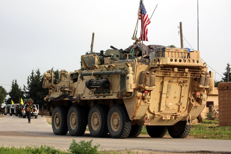 US forces, accompanied by Kurdish People's Protection Units (YPG) fighters, drive their armored vehicles near the northern Syrian village of Darbasiyah, on the border with Turkey on April 28, 2017. (AFP Photo/Delil Souleiman)