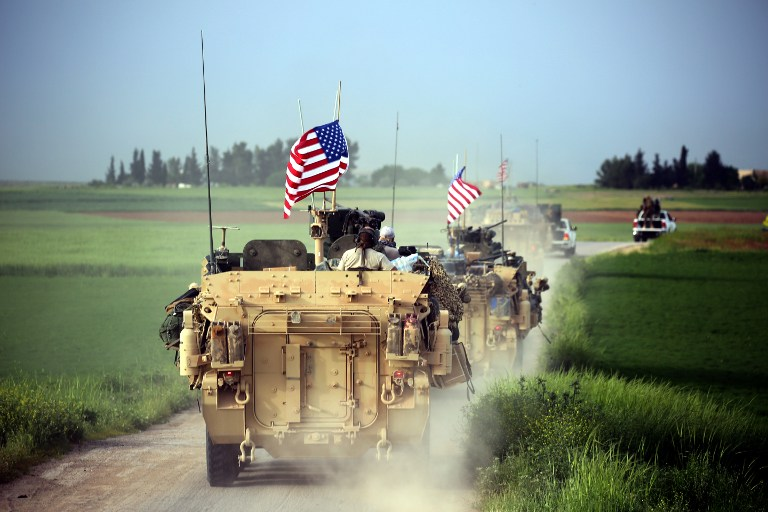 US forces, accompanied by Kurdish People's Protection Units (YPG) fighters, drive their armored vehicles near the northern Syrian village of Darbasiya on April 28, 2017. (AFP/Delil Souleiman)