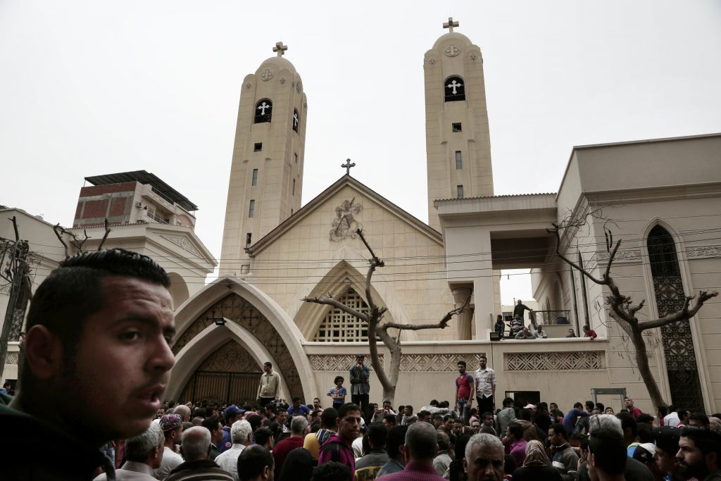 People gather outside the St. George's Church after a suicide bombing, in the Nile Delta town of Tanta, Egypt, Sunday, April 9, 2017. (AP Photo/Nariman El-Mofty)