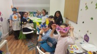 Leah (second from left) with other Camp Simcha siblings at the art group